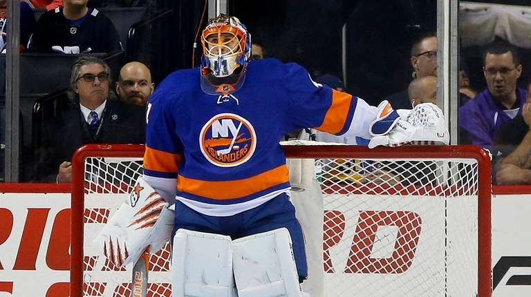 Jaroslav Halak of the Islanders looks on after