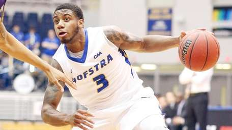 Hofstra's Justin Wright-Foreman works the ball against James