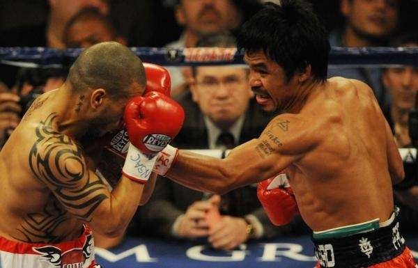 Manny Pacquiao (R) of the Philippines lands a