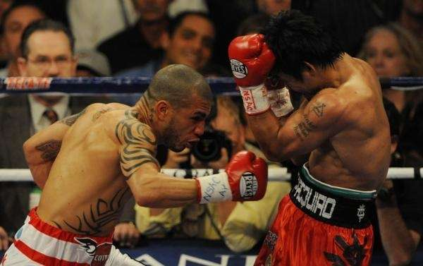 Manny Pacquiao (R) of the Philippines is punched