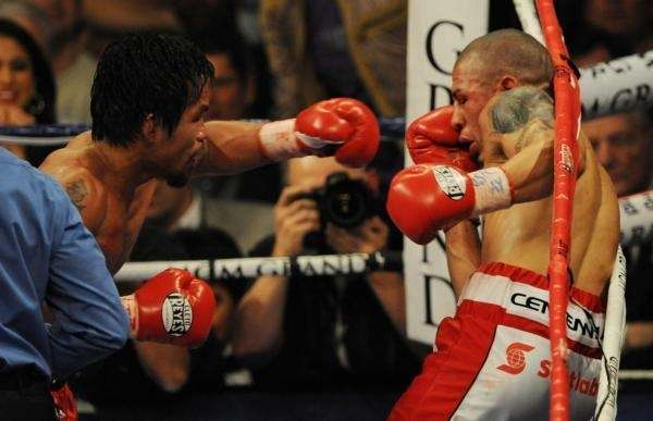 Manny Pacquiao (L) of the Philippines lands a