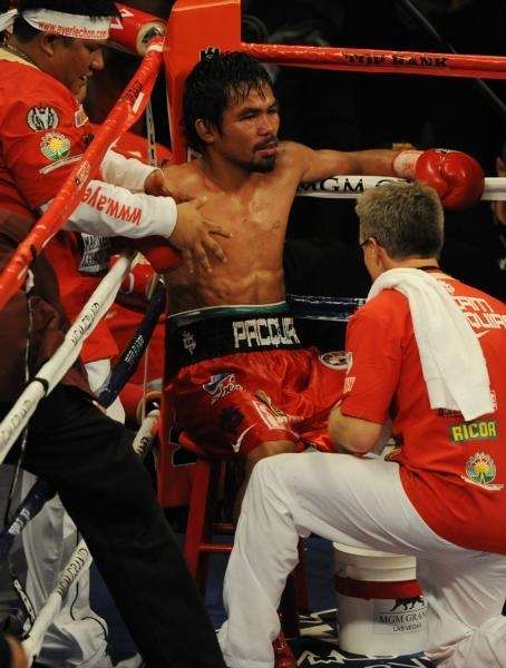 Manny Pacquiao of the Philippines sits in his