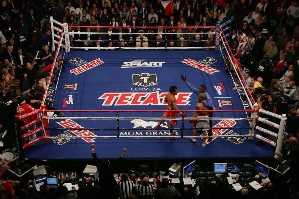 Manny Pacquiao celebrates his 12 round TKO victory