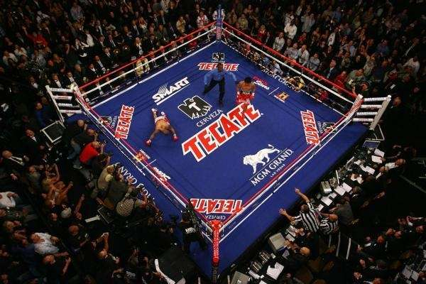 (L-R) Manny Pacquiao knocks down Miguel Cotto during