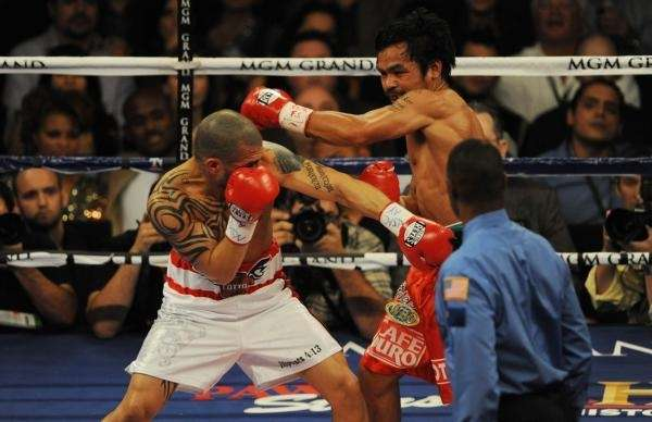 Manny Pacquiao (C) of the Philippines lands a