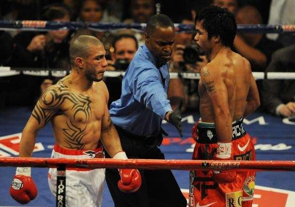 Manny Pacquiao (R) of the Philippines and Miguel