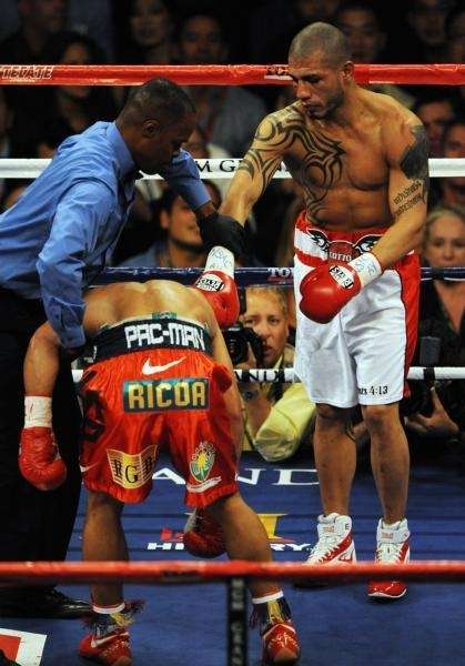 The referee seperates Miguel Angel Cotto of Puerto