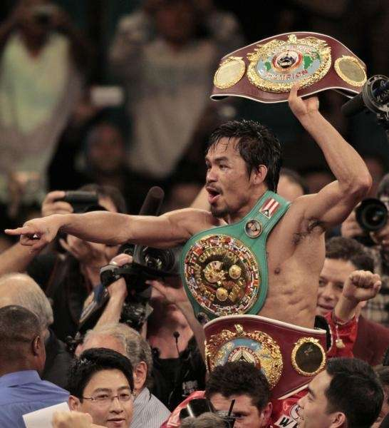 Manny Pacquiao, of the Philippines, holds the championship