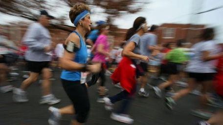 Runners participate in a 5K run in Mineola.