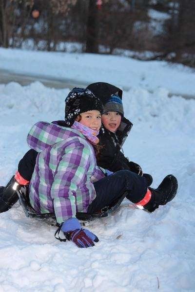 Madison 9 and Sammy 7 sledding in the