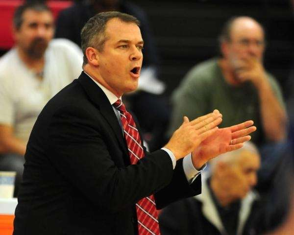 Stony Brook coach Steve Pikiell urges on his
