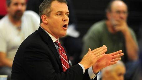 Stony Brook coach Steve Pikiell urges on his