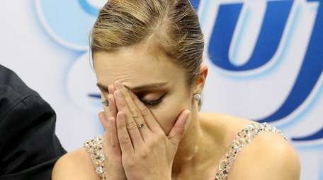 Ashley Wagner waits for her score in the