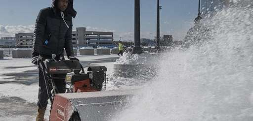 Dennis Russell clears snow at Nassau Coliseum in