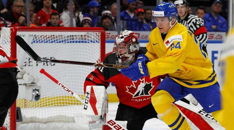 Sweden forward Lias Andersson skates past Canada goalie