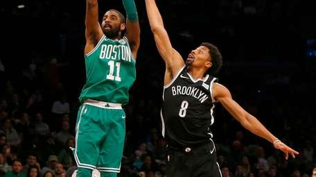 Kyrie Irving of the Celtics puts up a