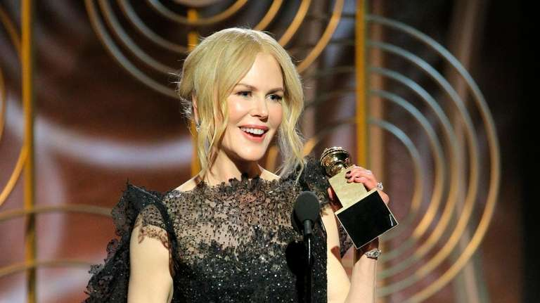Nicole Kidman accepts the award for best performance