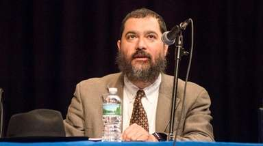 Superintendent Shimon Waronker during Hempstead's school board meeting