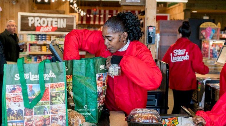 Cashier Lorna Horton packs a customer's reusable bags