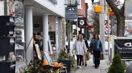 Shoppers stroll down Main Street in the downtown