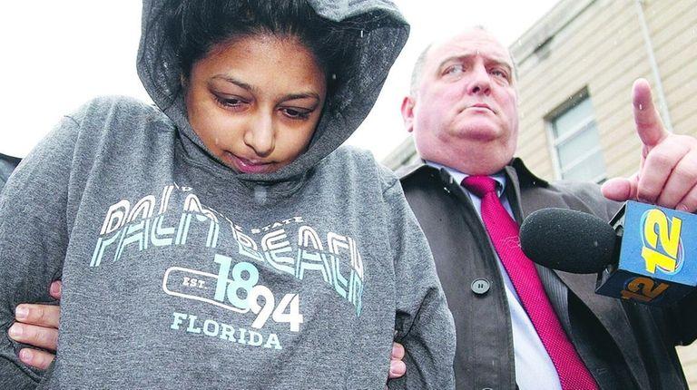 Sharon Seudat leaves Nassau Police headquarters in Mineola