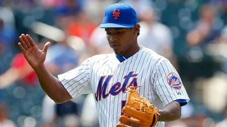 Mets pitcher Jenrry Mejia reacts during a game