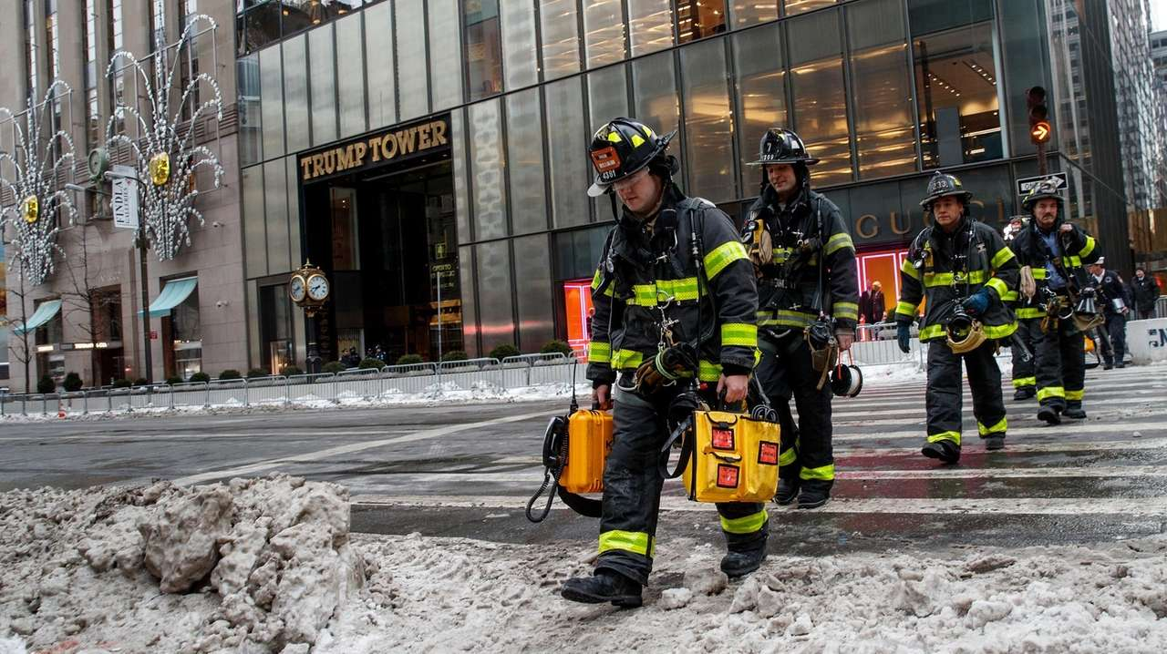 Firefighters exit Trump Tower after responding to a