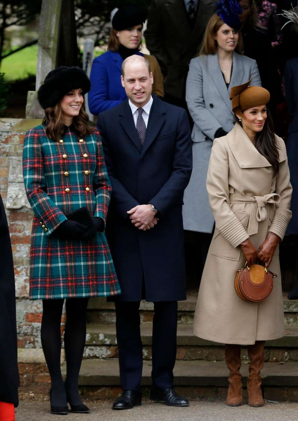Kate, Prince William and Meghan Markle wait for