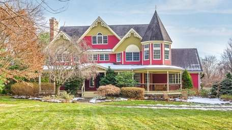 The house mimics Victorians of yesteryear, with red