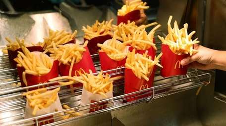 McDonald's French fries are prepared on April 25,