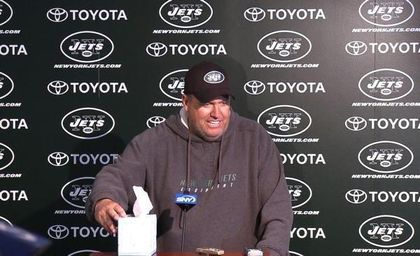 Jets head coach Rex Ryan carries a box