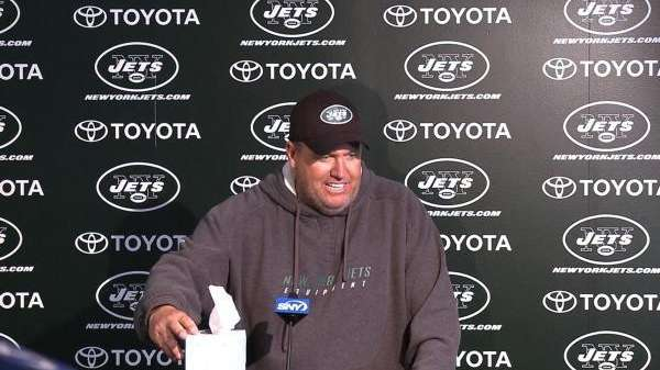 Jets head coach Rex Ryan carries a box