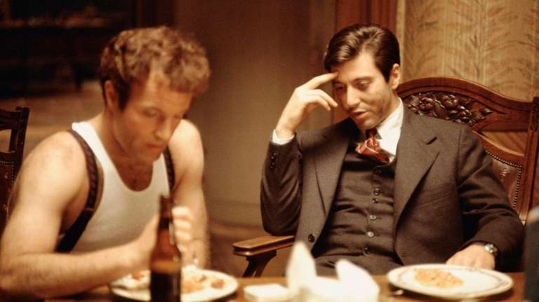 Sonny and Michael Corleone strategize over dinner in