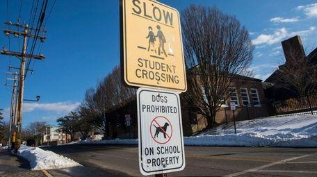 A sign on Port Washington school district property,