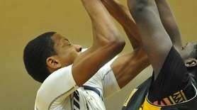 Nasim Cylin #23 of Baldwin, left, looks to