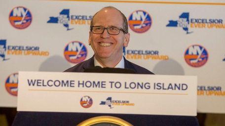 Islanders co-owner Jon Ledecky smiles during the announcement