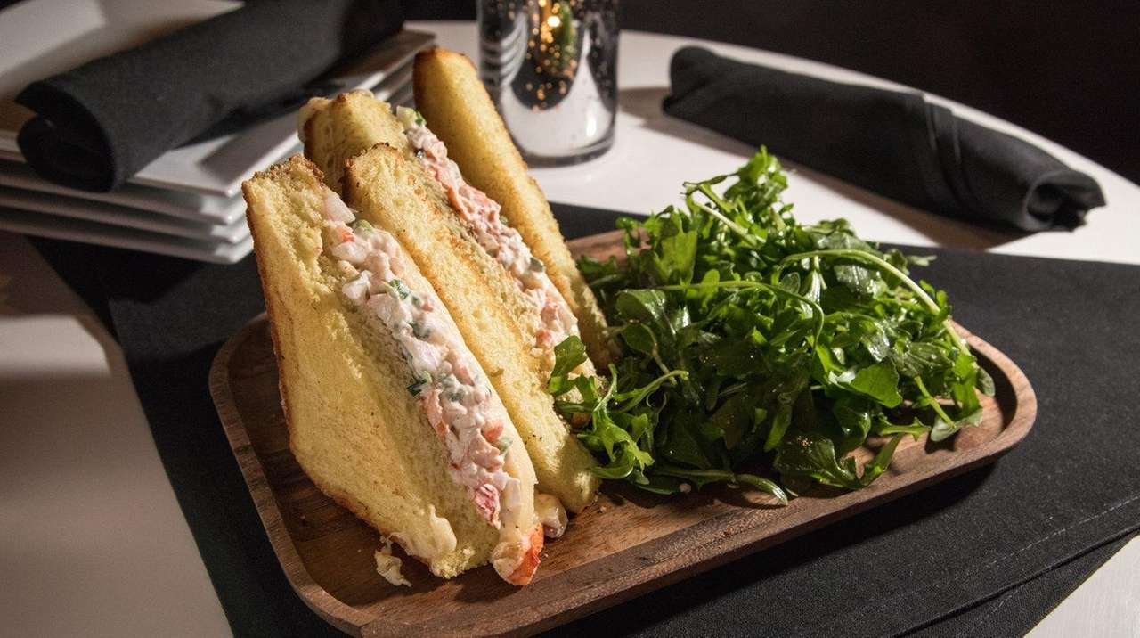 A lobster grilled cheese sandwich oozes with melted
