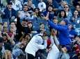 Fans try to catch a foul ball during