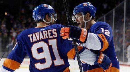 Islanders right wing Josh Bailey celebrates with John