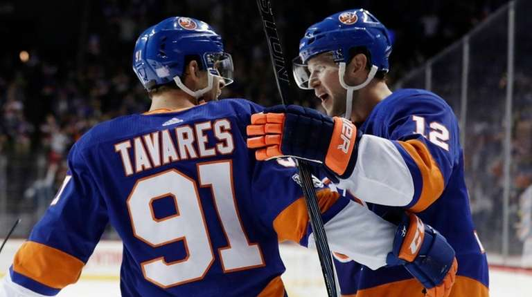 Islanders right wing Josh Bailey celebrates with John