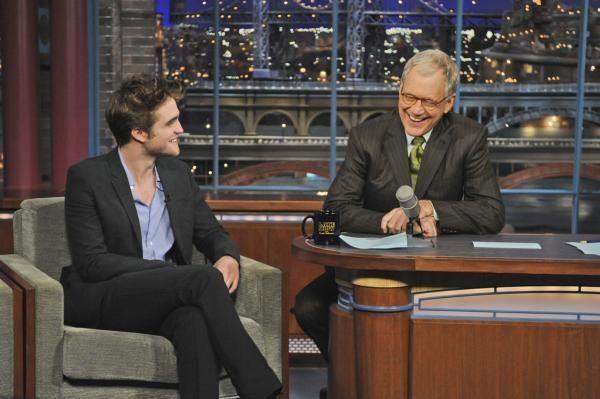 Actor Robert Pattinson laughs with host David Letterman