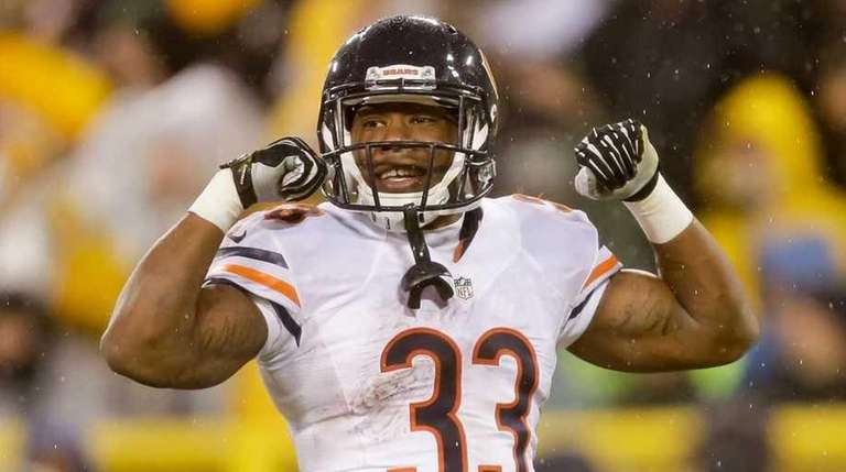 Jeremy Langford of the Bears reacts after scoring
