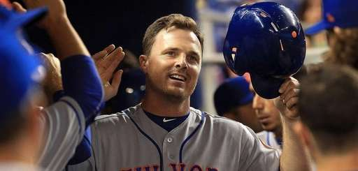 Jay Bruce of the Mets is congratulated after