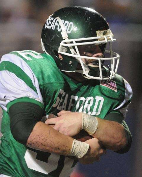 Seaford running back Justin Buckley carries the ball
