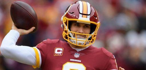 Washington Redskins quarterback Kirk Cousins (8) warms up