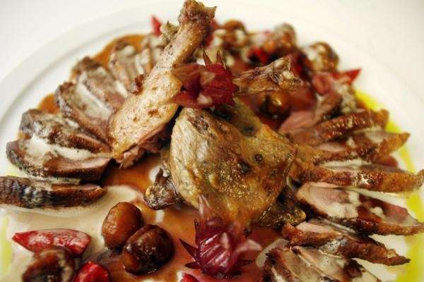 Whole-roasted Hudson Valley duck is served at Lola,