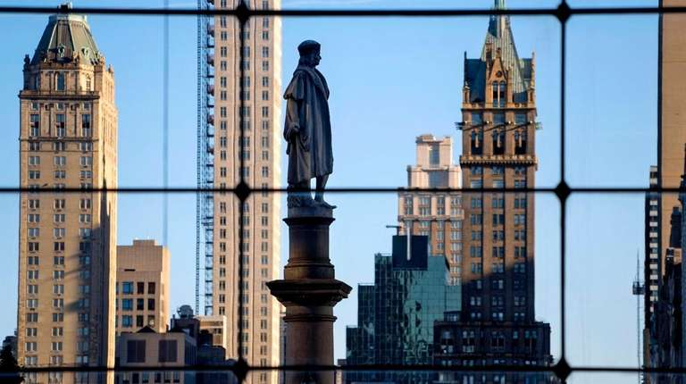 The statue of Christopher Columbus is seen through