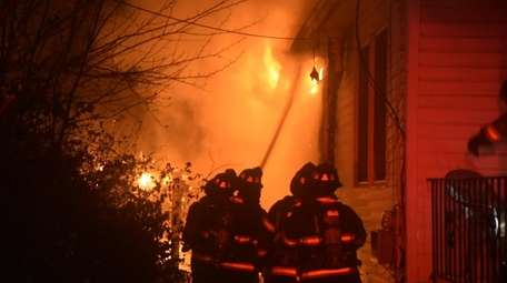 The Copiague Fire Department responds to a house