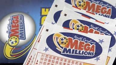 Mega Millions lottery tickets rest on a counter