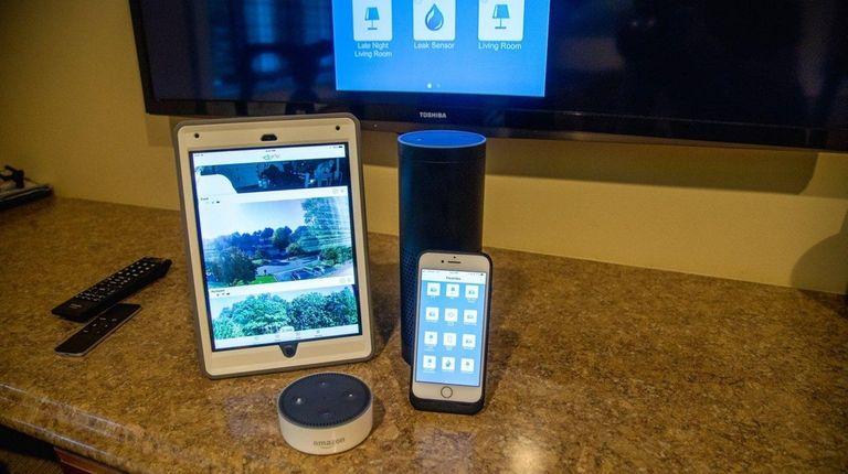 An iPad, iPhone, and Alexa.